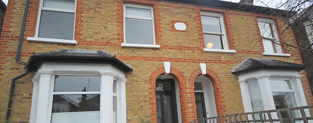 Paint strip and repointing, London
